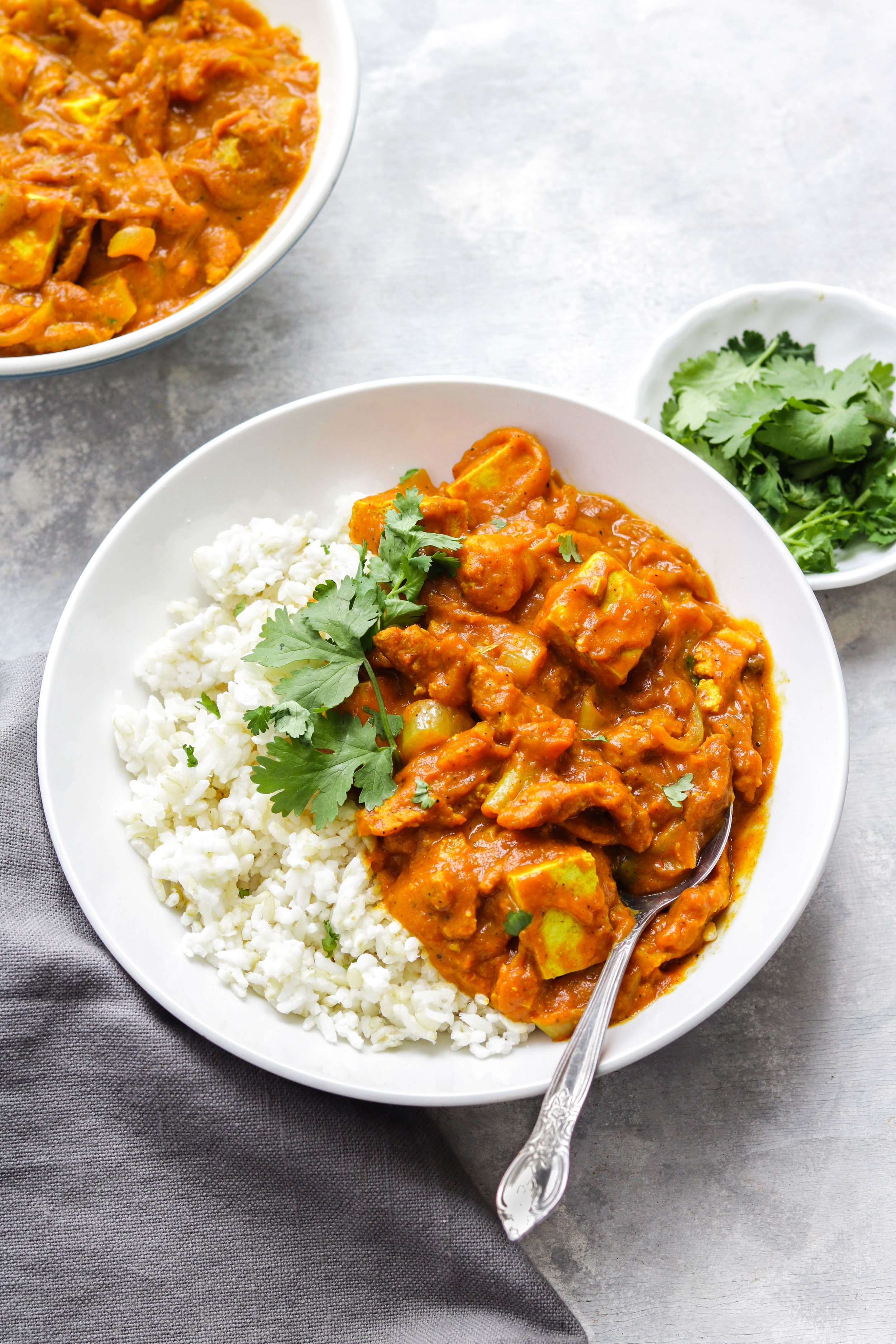 tofu butter chicken in a bowl with cilantro