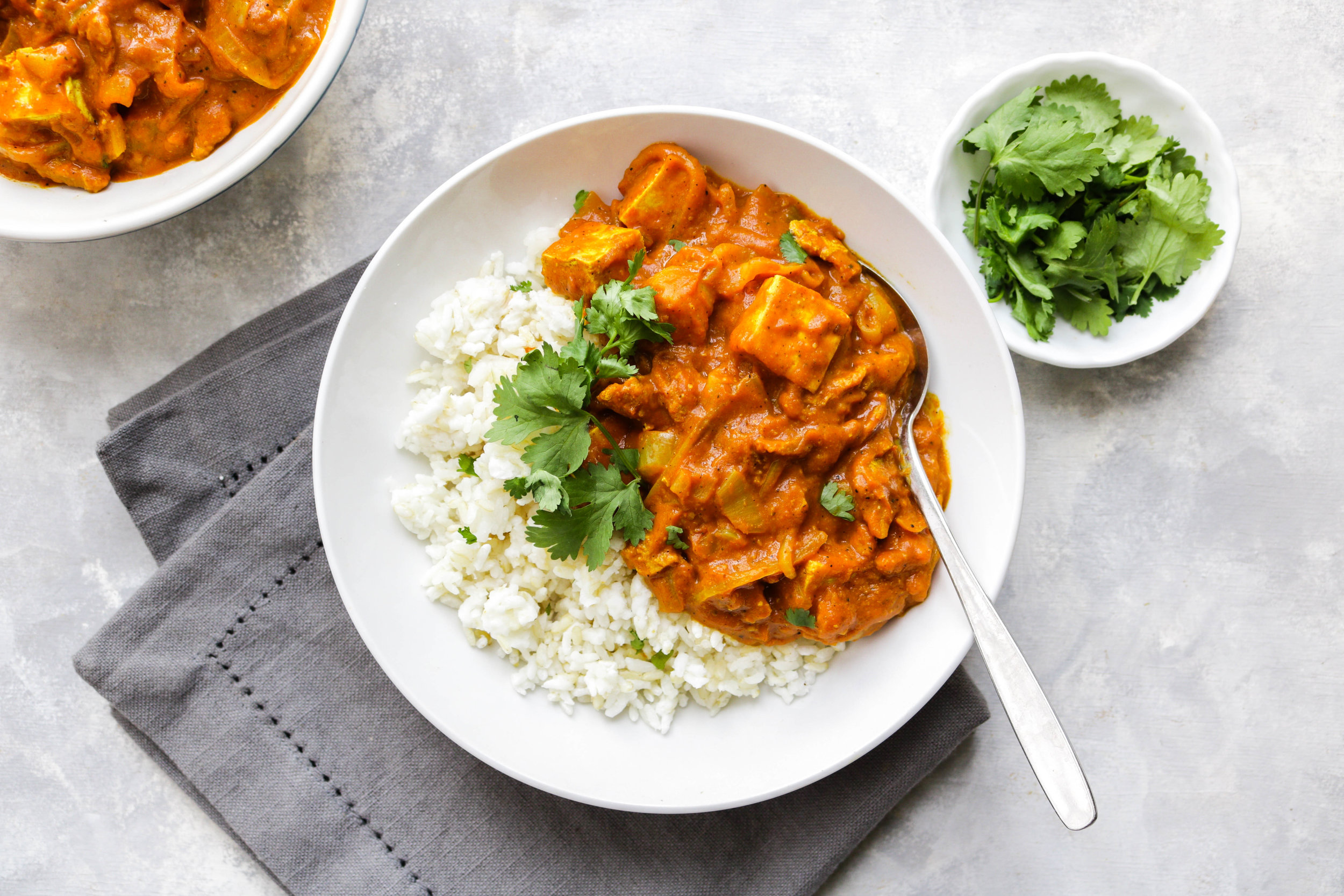 vegan butter chicken with tofu in a white bowl landscape photo