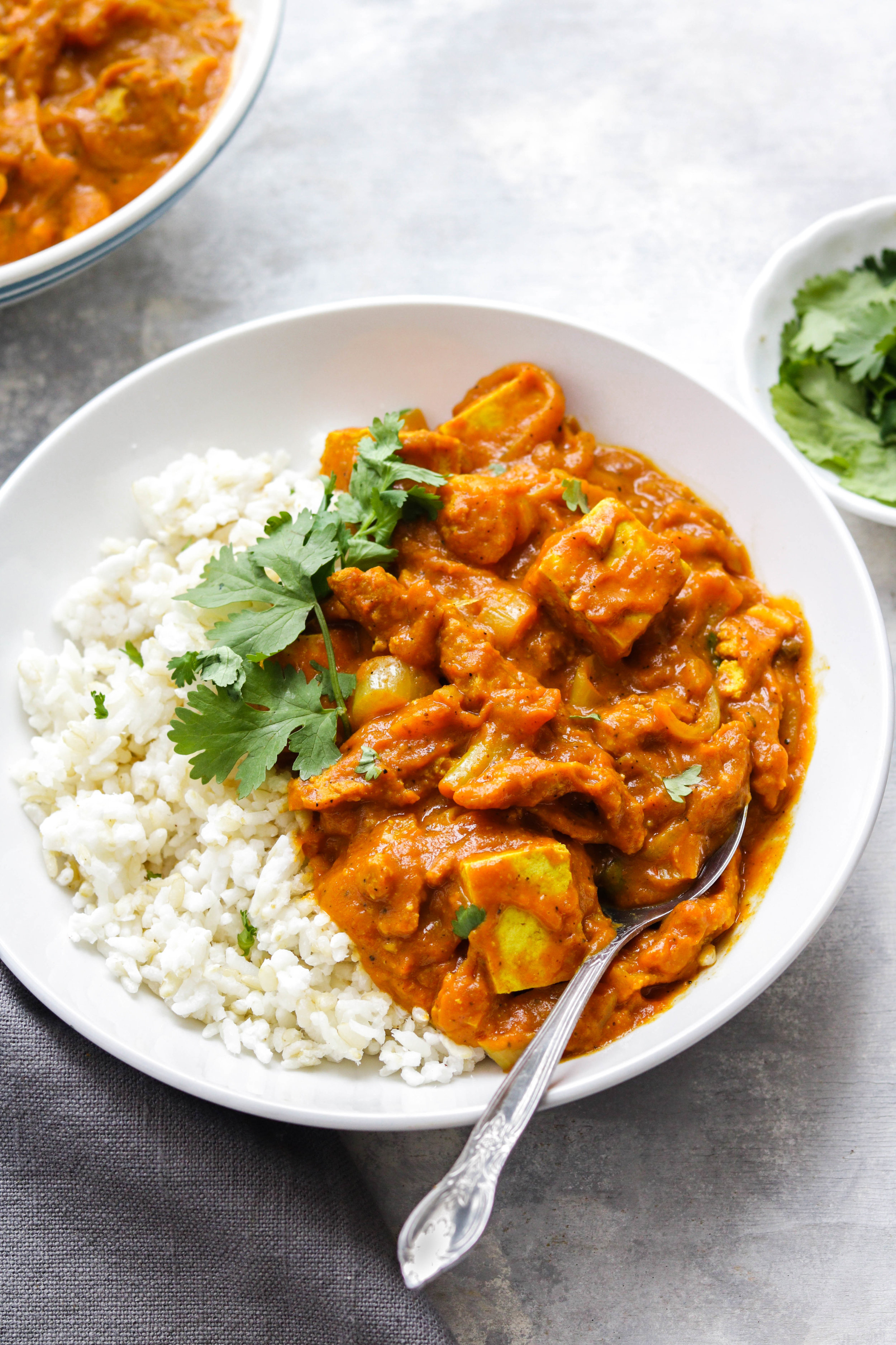 vegan butter chicken with tofu in a white bowl