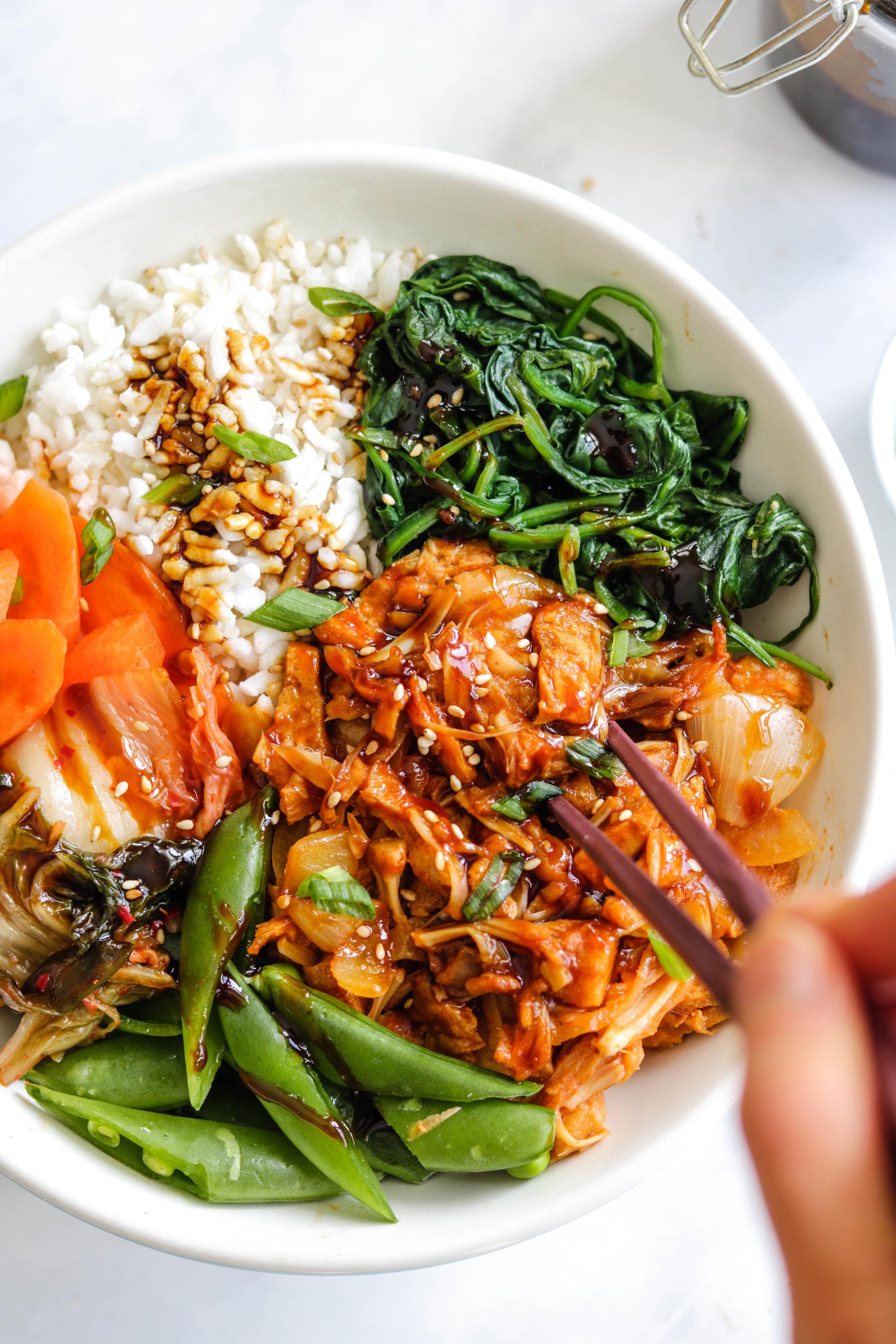 vegan korean BBQ pulled pork in white bowl close up