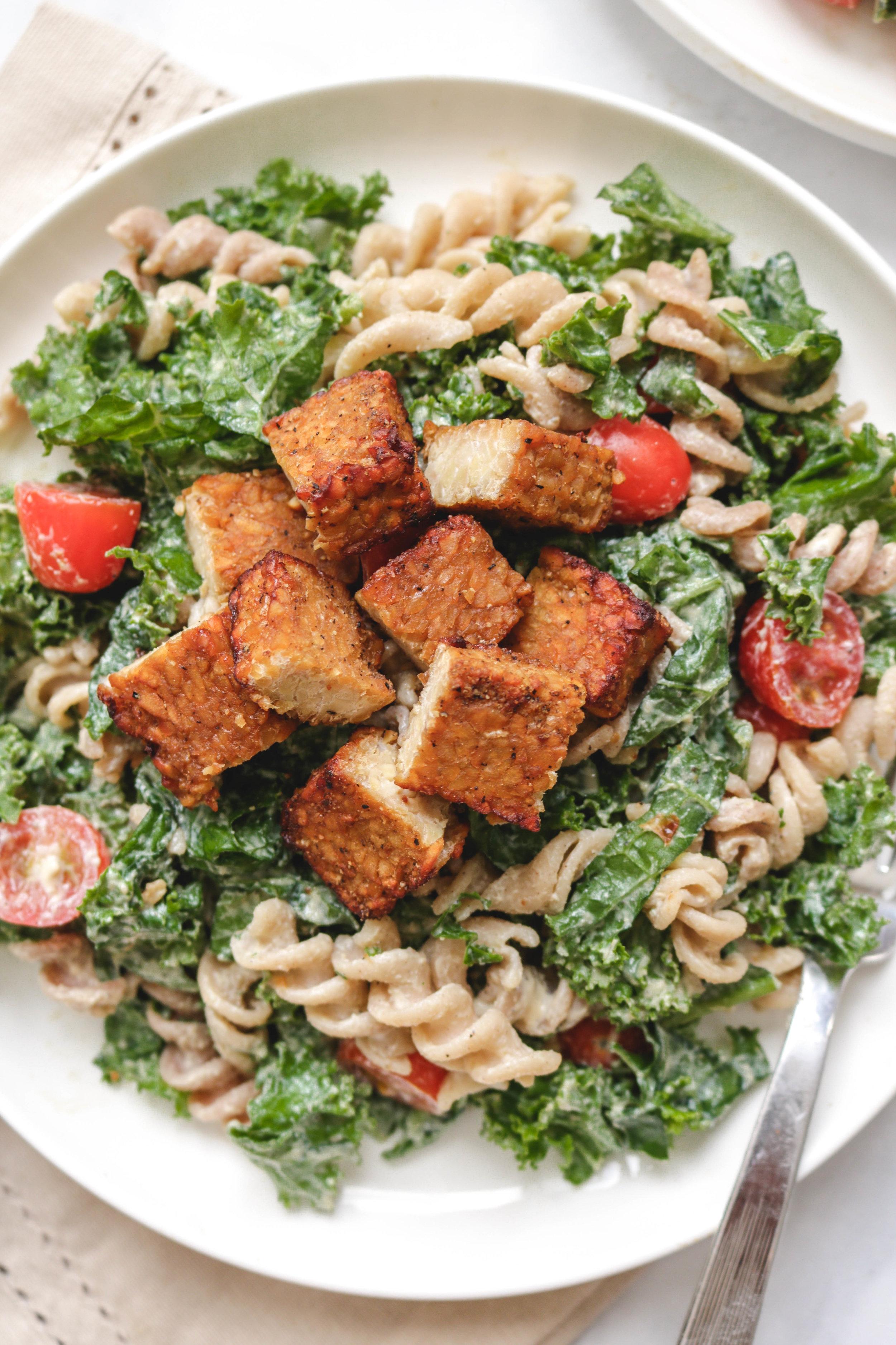 vegan caesar dressing kale salad on white plate close up