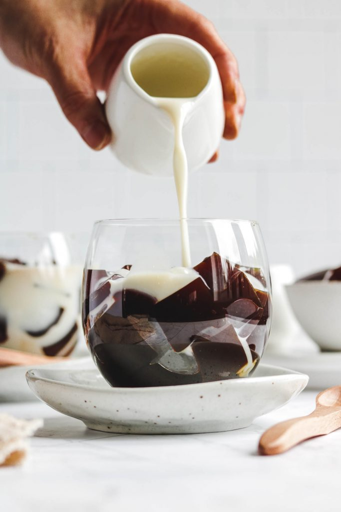 pouring milk into coffee jelly dessert