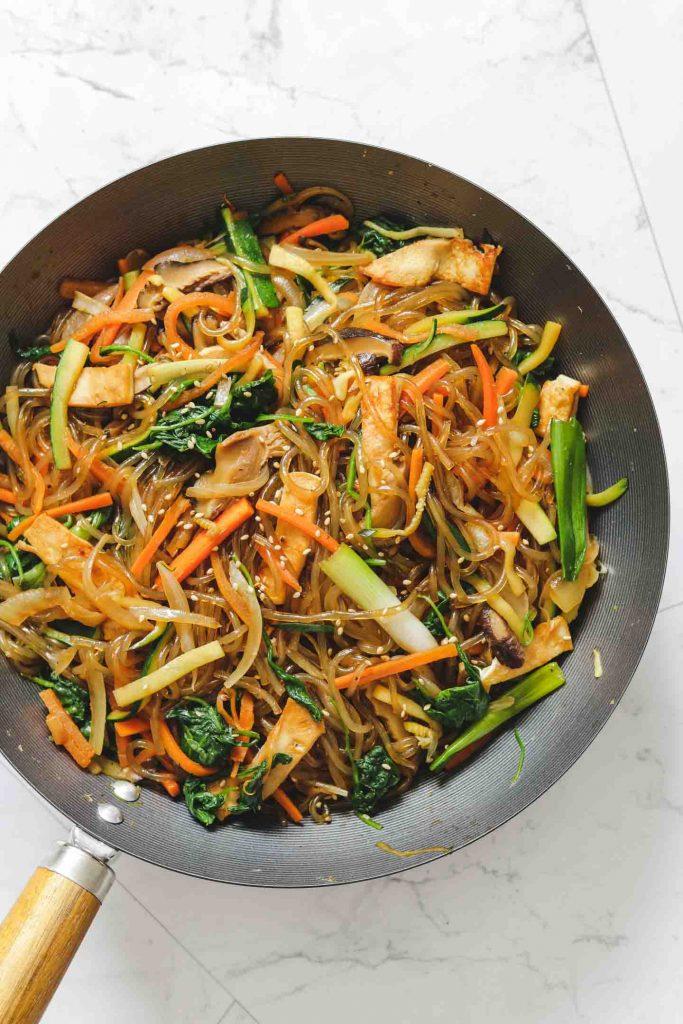 vegetable sweet potato noodles in a wok