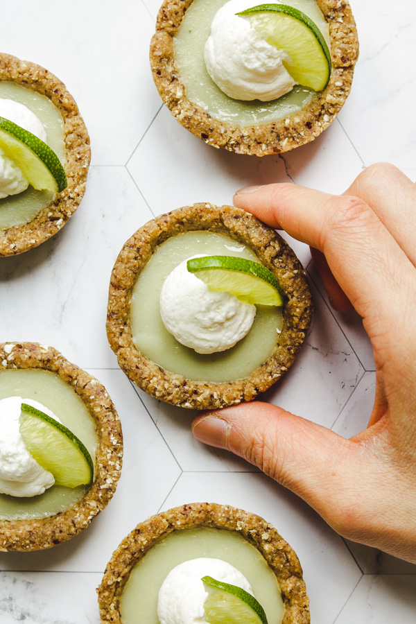 non dairy no bake key lime pies in hands