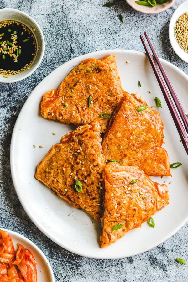 korean pancakes on white plate close up