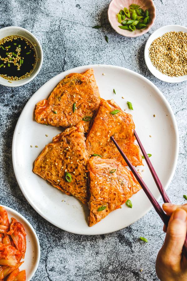 eating vegan kimchi pancakes