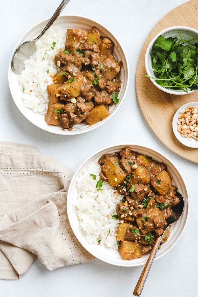 two vegetarian massaman curry in white bowl