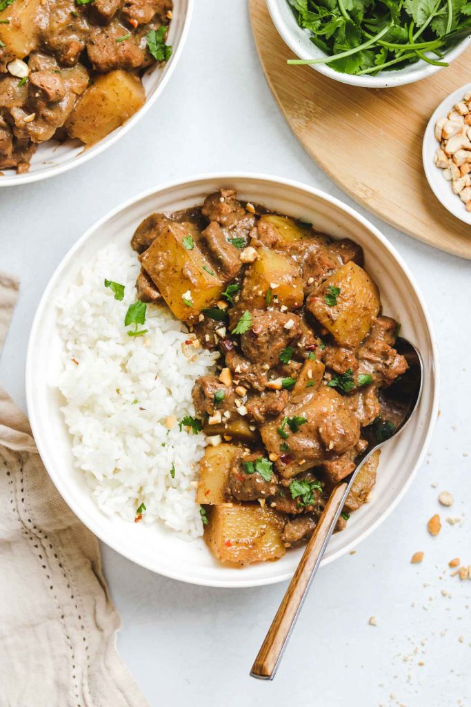 vegan massaman curry in white bowl