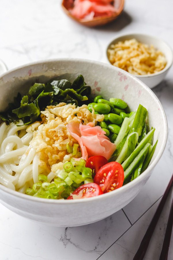tanuki udon noodles in a bowl side photo
