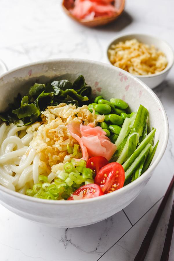 tanuki udon noodles in a bowl side photo