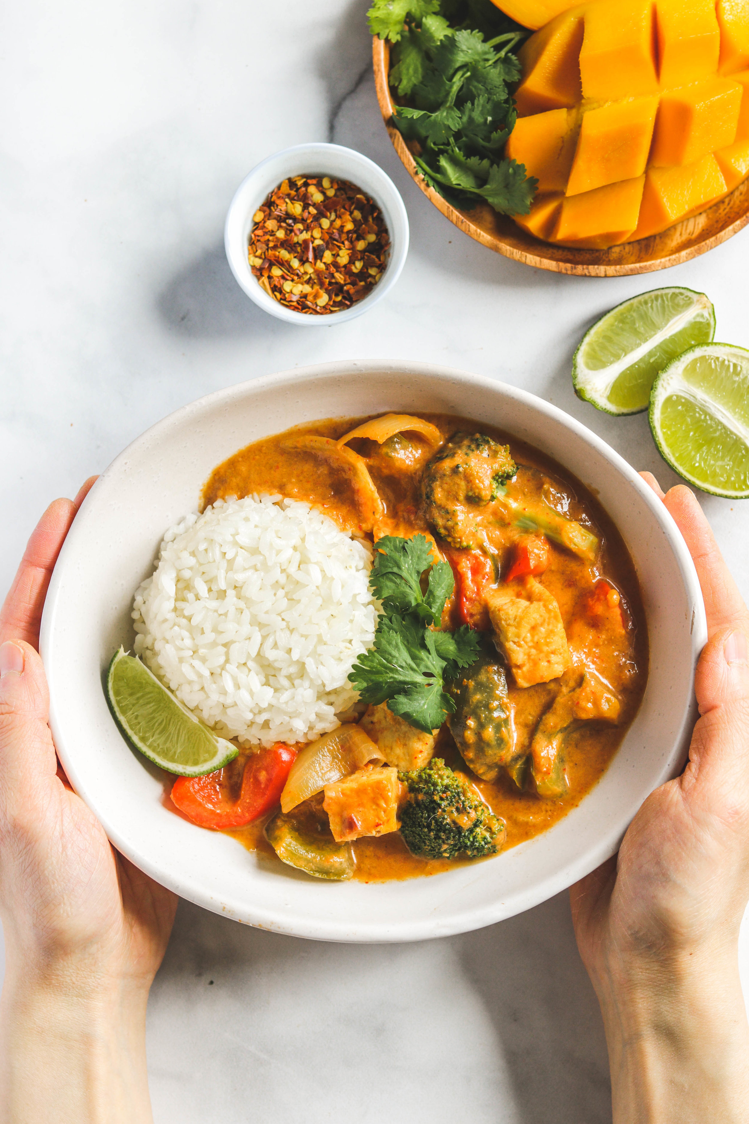 mango coconut tofu curry in white bowl
