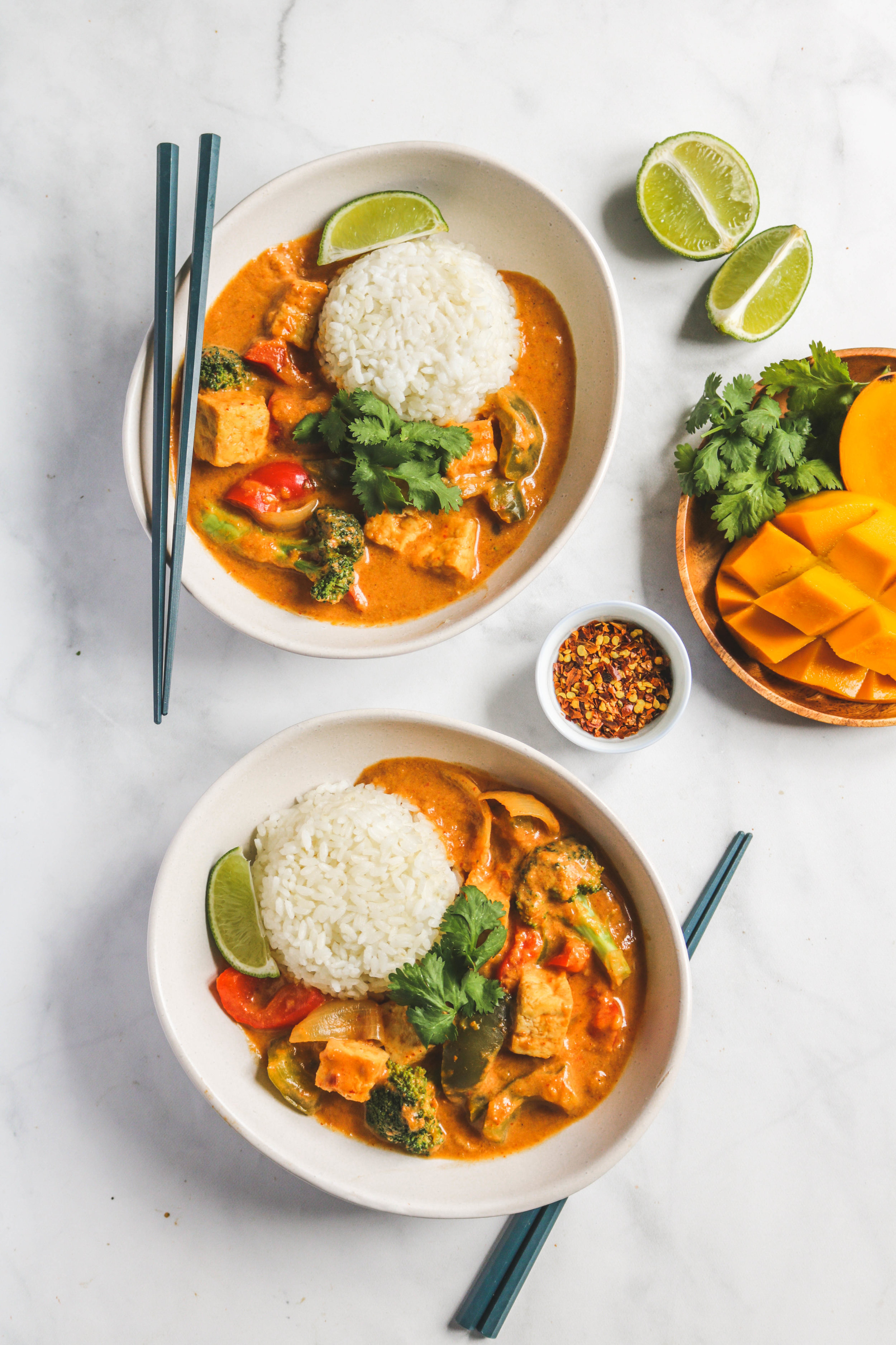 mango coconut thai curry in white bowls