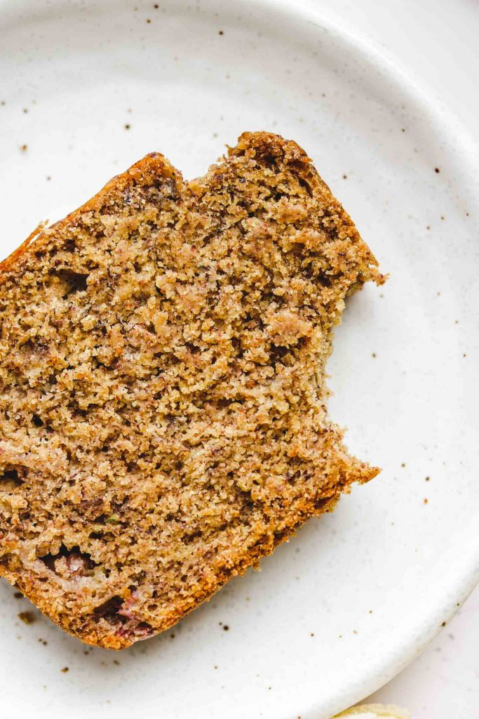 healthy banana bread on a white plate bite shot