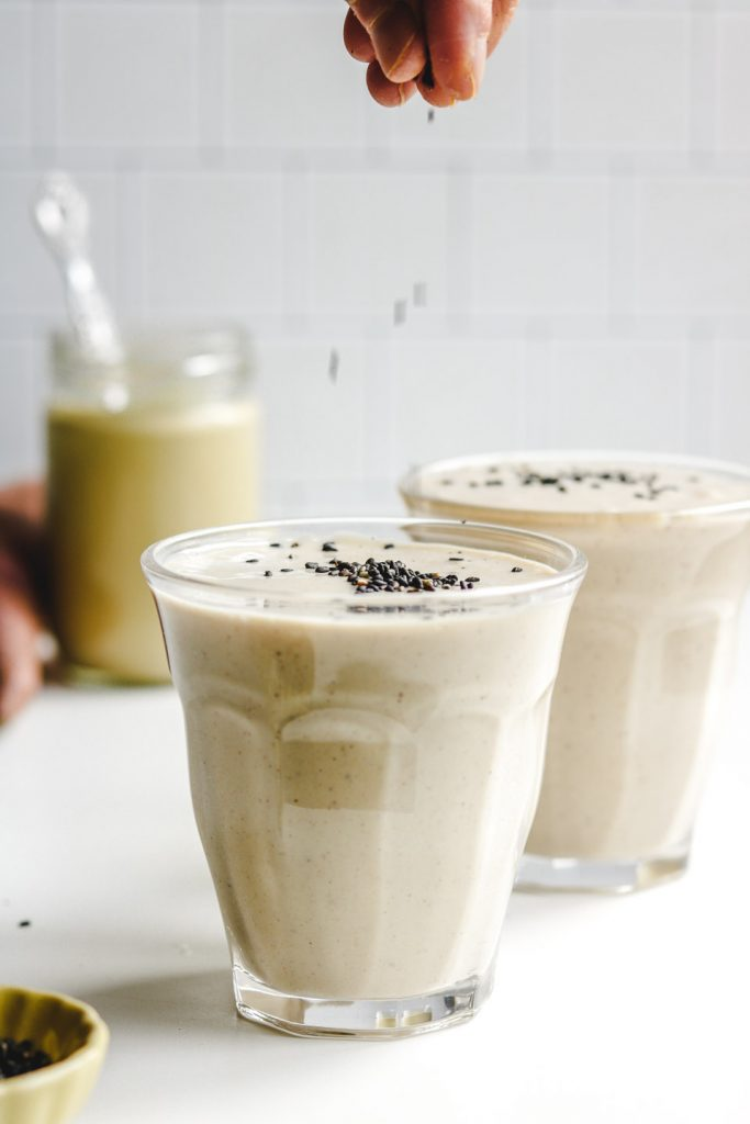 japanese sweet potato smoothie adding black sesame seeds on top
