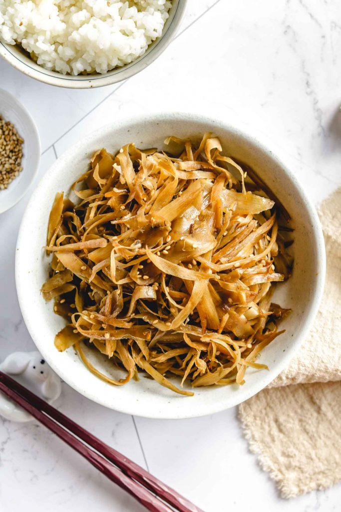 japanese braised burdock in a white bowl