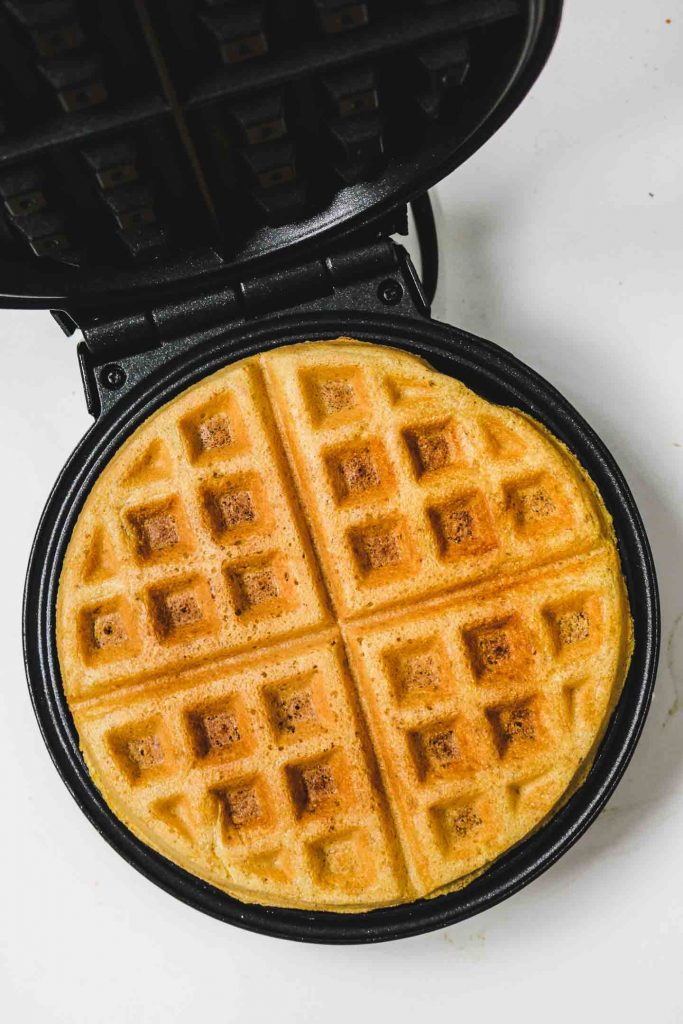 cornbread waffles on a waffle iron finished