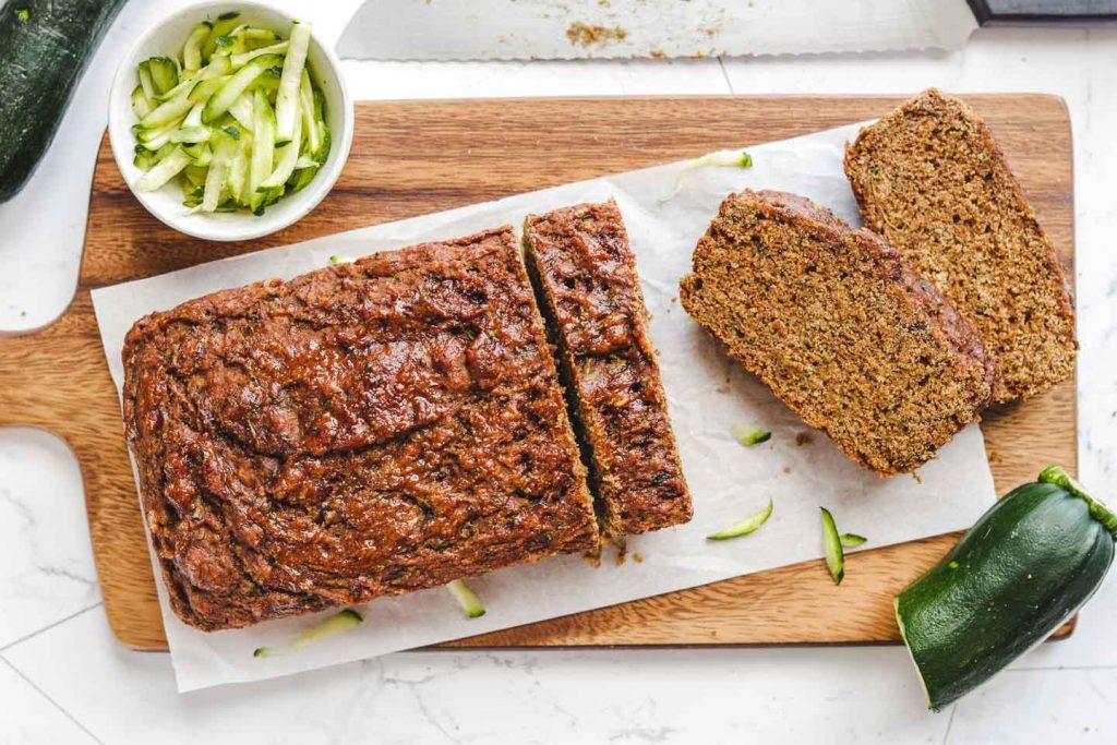 vegan gluten free zucchini bread sliced on a cutting board
