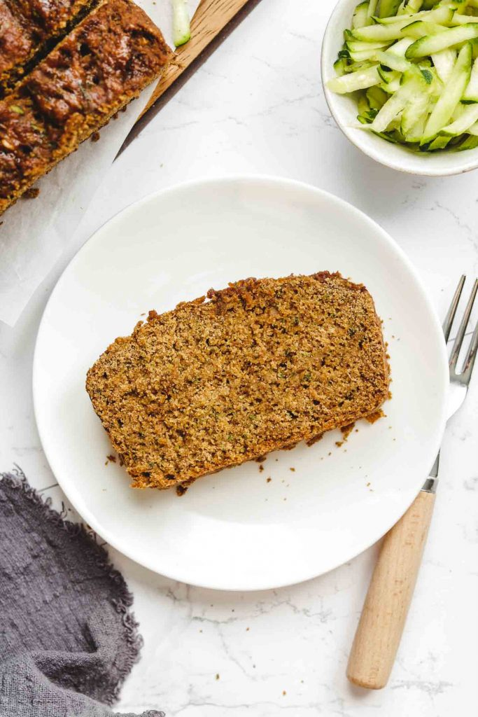 vegan fluffy moist zucchini bread on a white plate