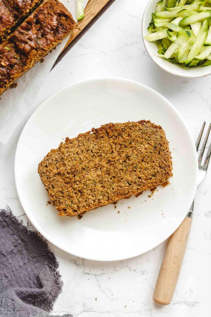 vegan fluffy moist zucchini bread on a white plate