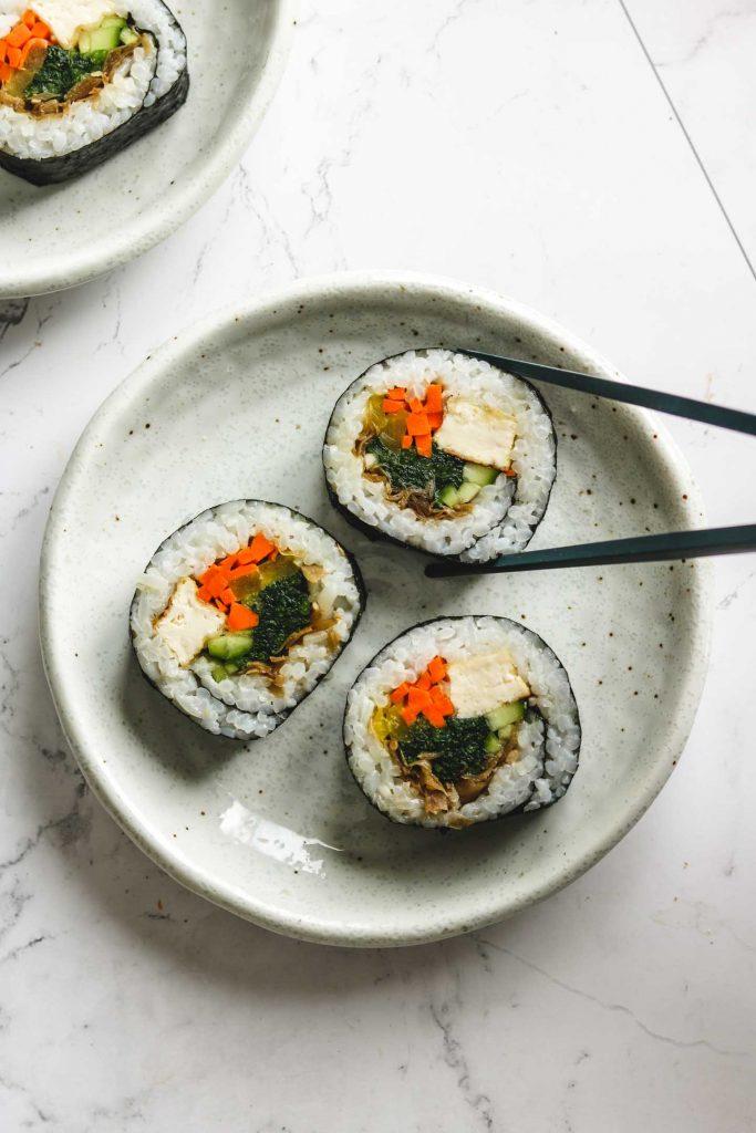 vegetable tofu kimbap on a white plate