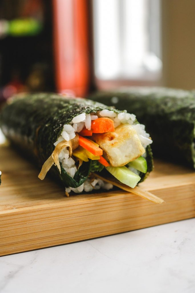 kimbap close up photo with tofu and vegetables