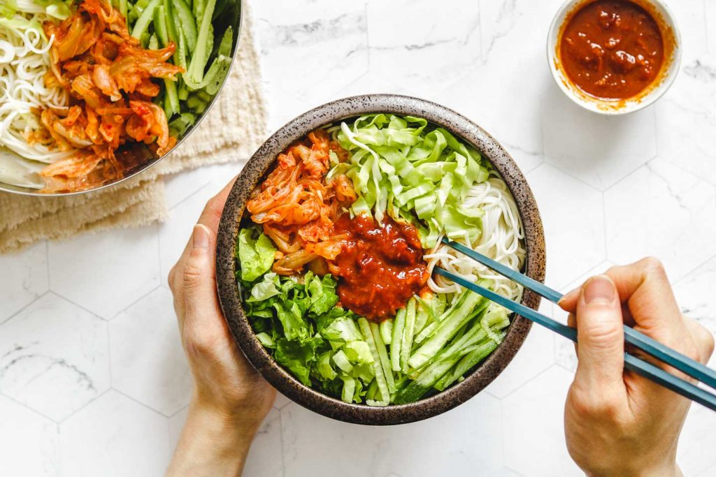 korean spicy cold noodles in a brown bowl landscape