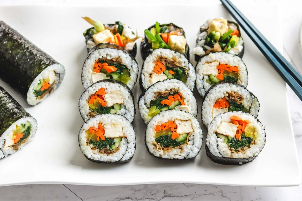 vegan kimbap with tofu on large white plate