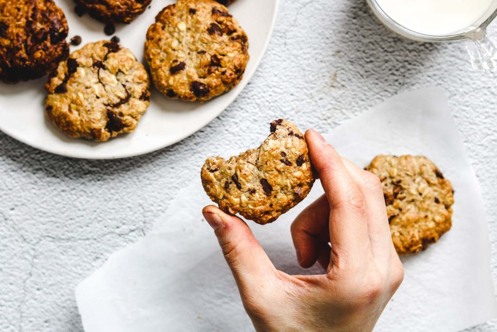 air fried tahini oatmeal chocolate chip cookies holding in one hand