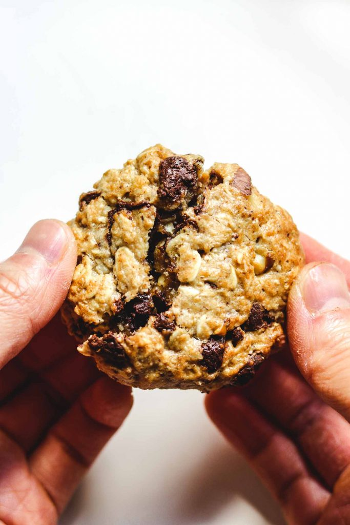 breaking open a oatmeal chocolate chip cookie