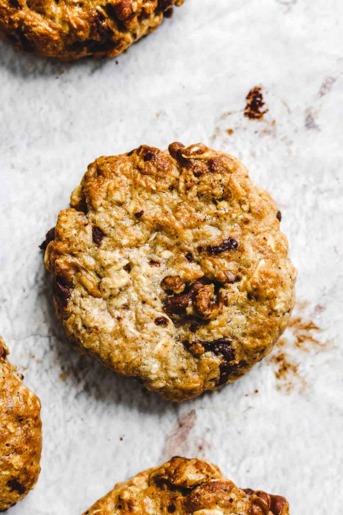 Air Fryer Tahini Chocolate Chunk Oatmeal Cookies on parchment paper