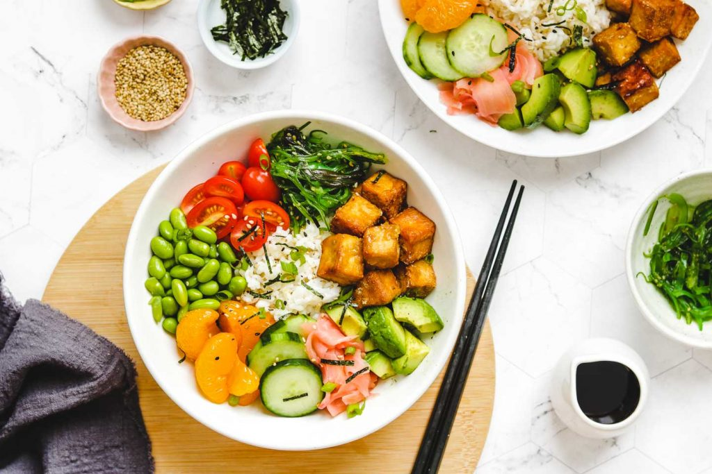 vegan tofu poke bowl with vegetables crispy tofu on a board landscape photo