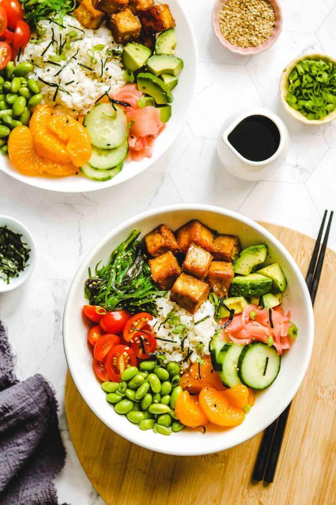 vegan tofu poke bowl with vegetables crispy tofu on a board