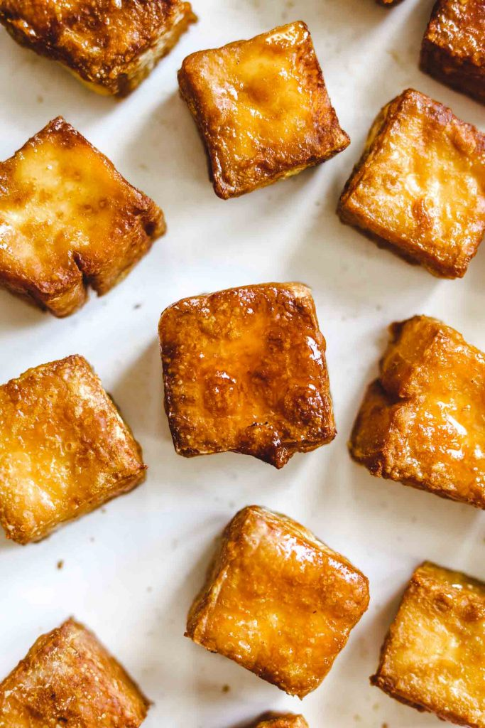 crispy air fried tofu in a bowl on parchment paper