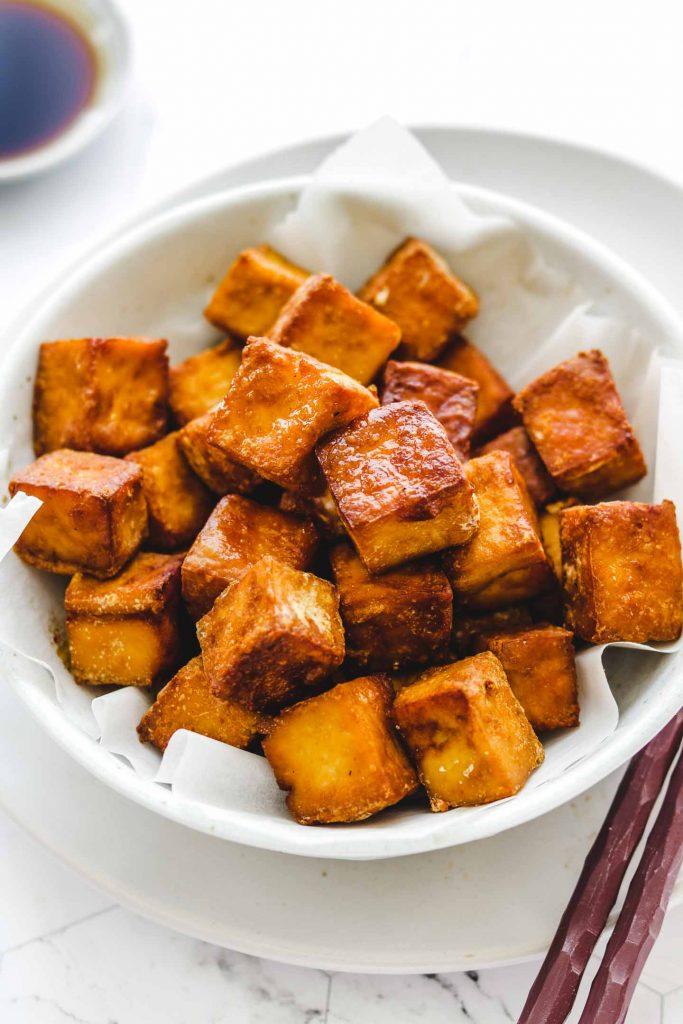 close up shot of crispy tofu in a bowl