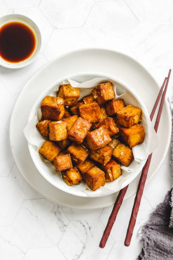 close up shot of crispy tofu in a bowl