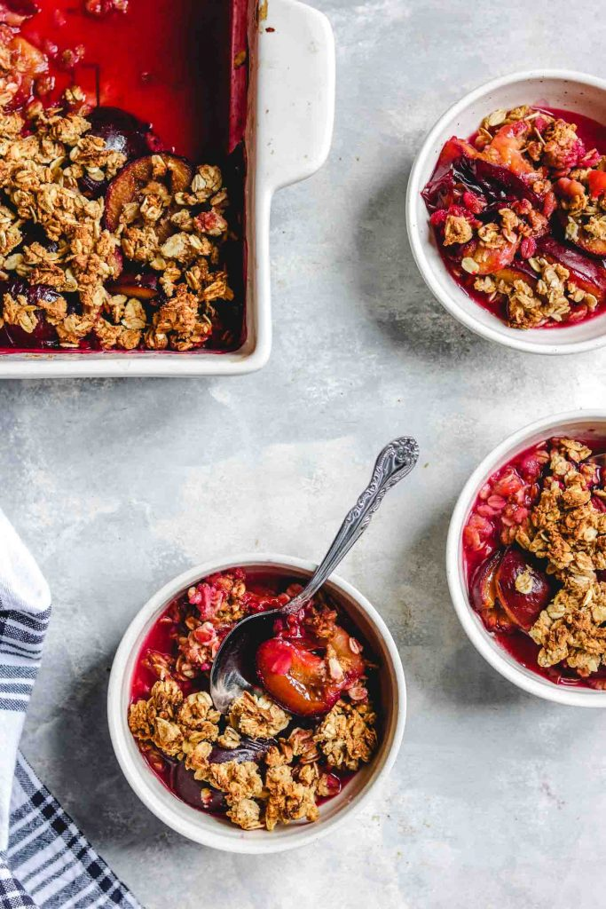 plum crisp served into three bowls with no ice-cream