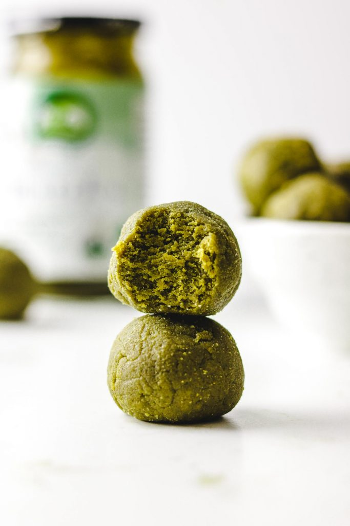 vegan matcha energy balls close up bite shot photo stacked on another energy ball