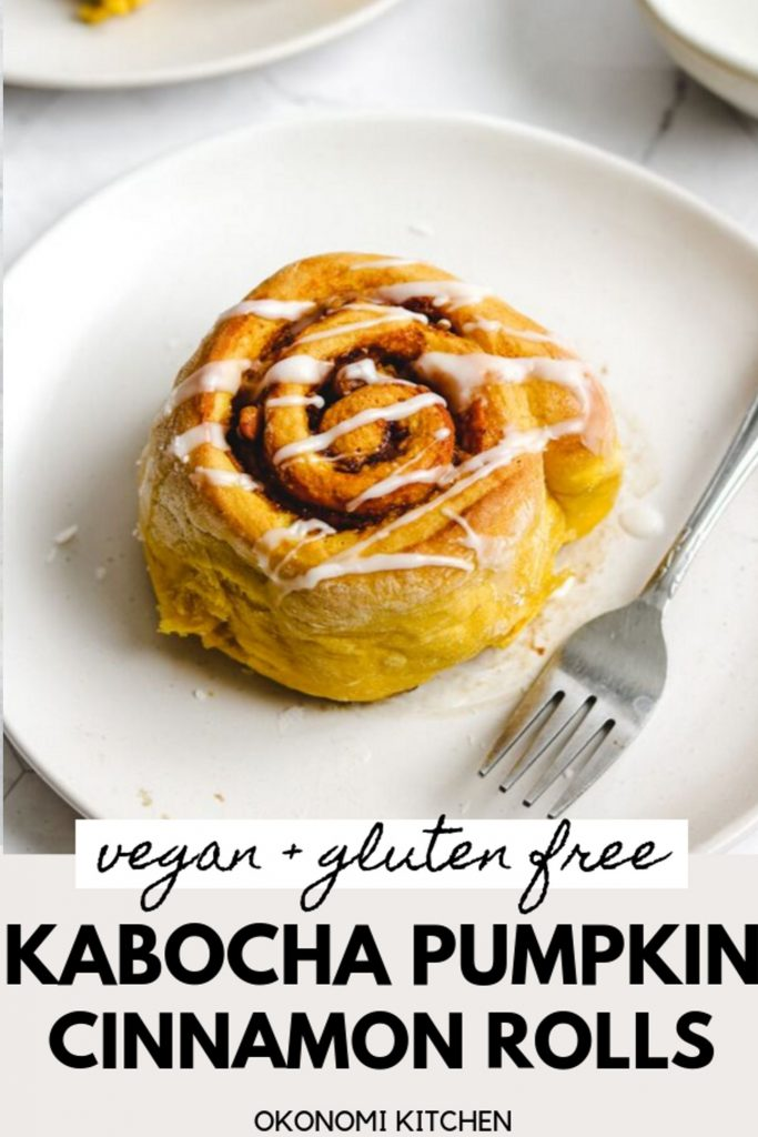 vegan gluten free pumpkin cinnamon roll with glaze on top on a white plate and fork pinterest