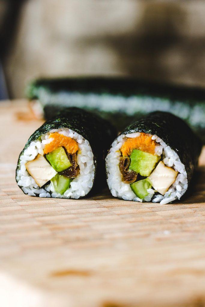 vegan take away sushi rolls on bamboo board