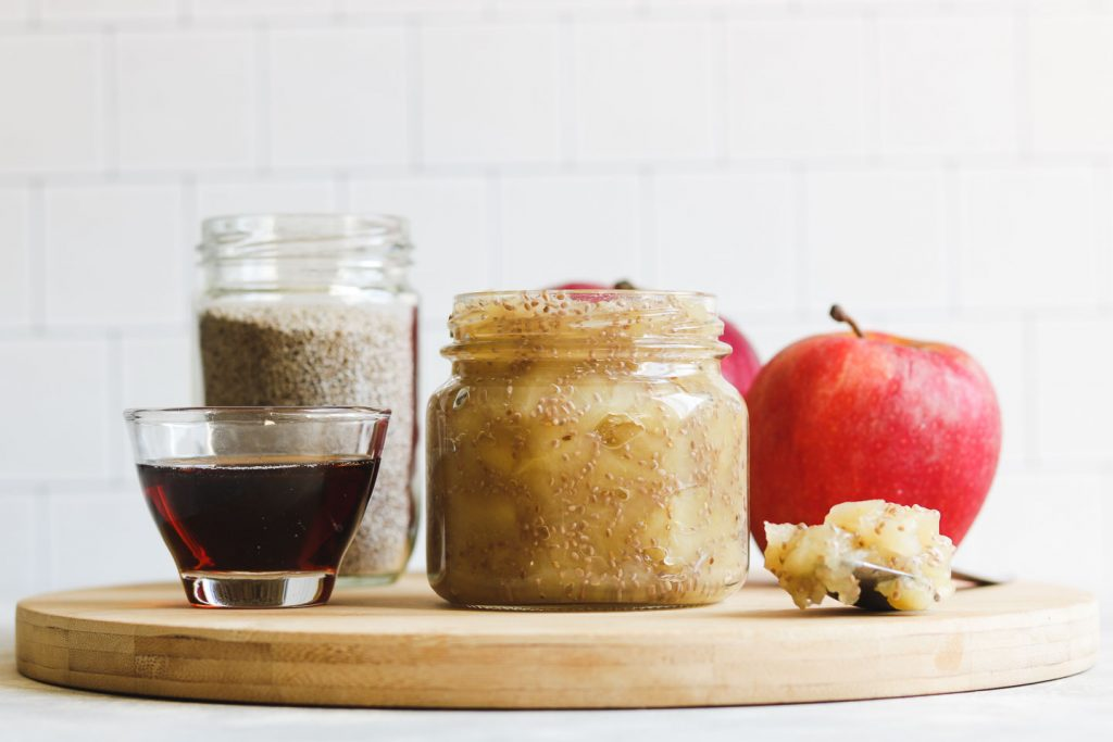 apple chia jam in a jar landscape photo on a cheese board