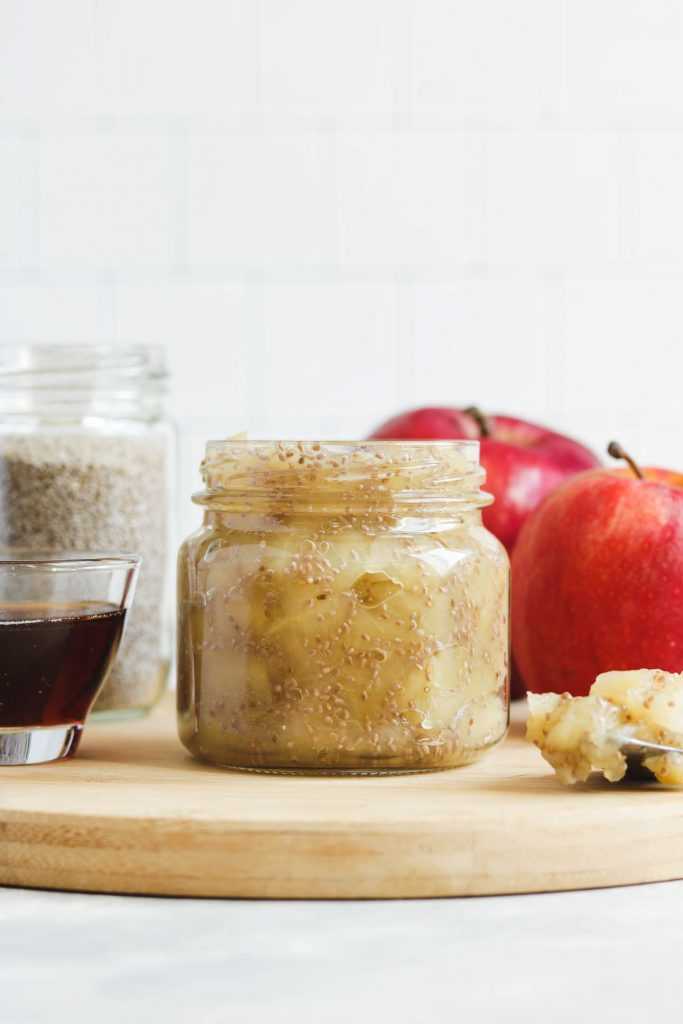 apple chia jam in a canning jar on a cheese board