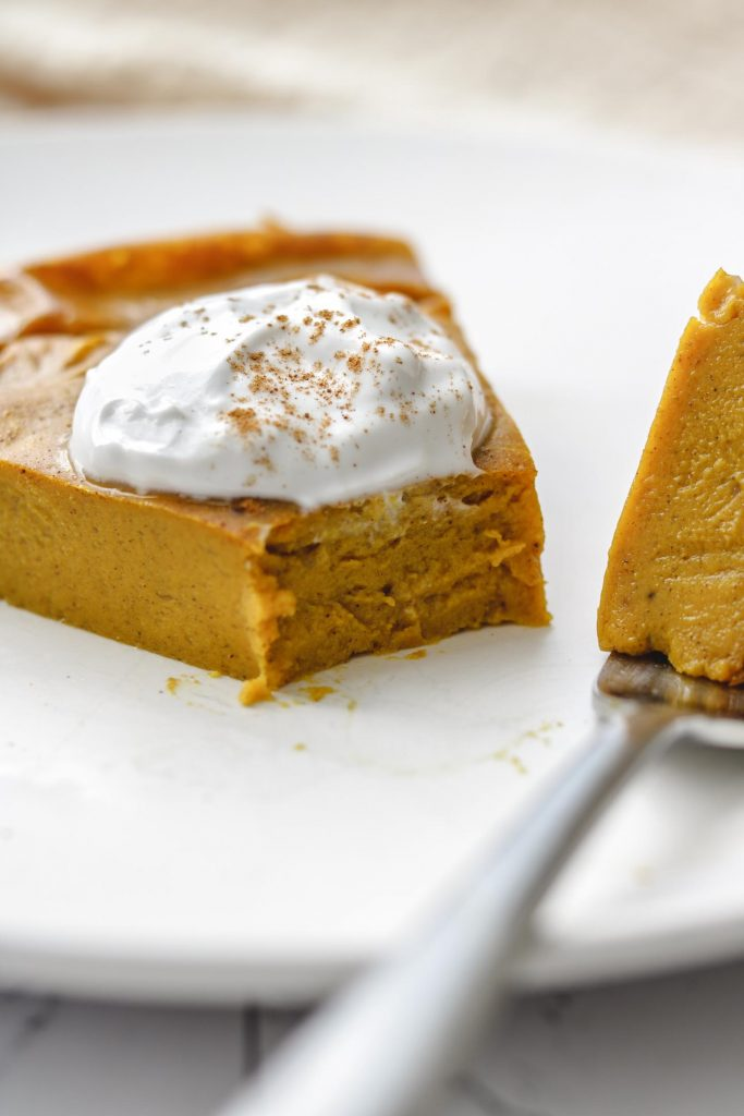 low calorie vegan crustless pumpkin pie on a white plate close up photo
