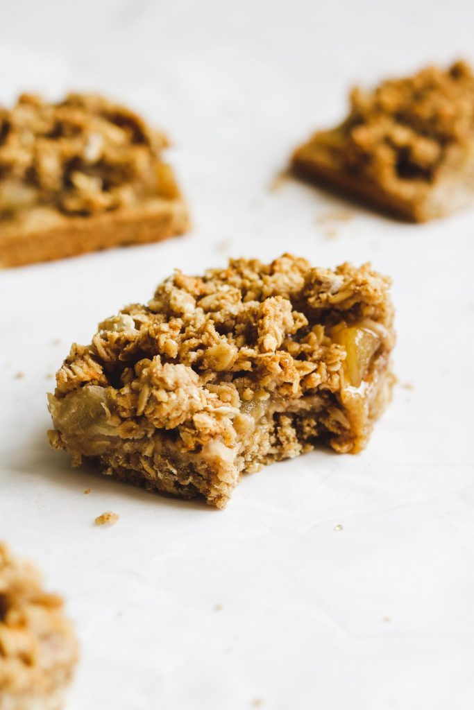 crumb bars with apple jam cut out and bit into it