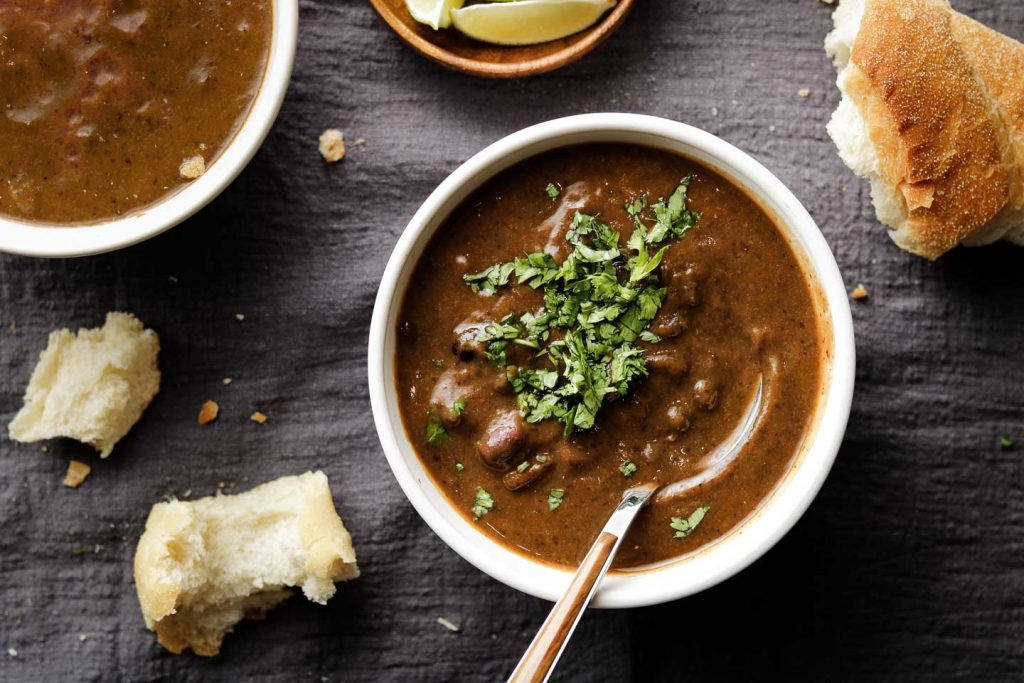 black bean soup in a white bowl with cilantro landscape photo