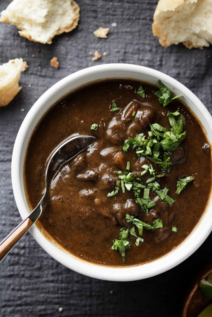 black bean soup in a bowl with bread