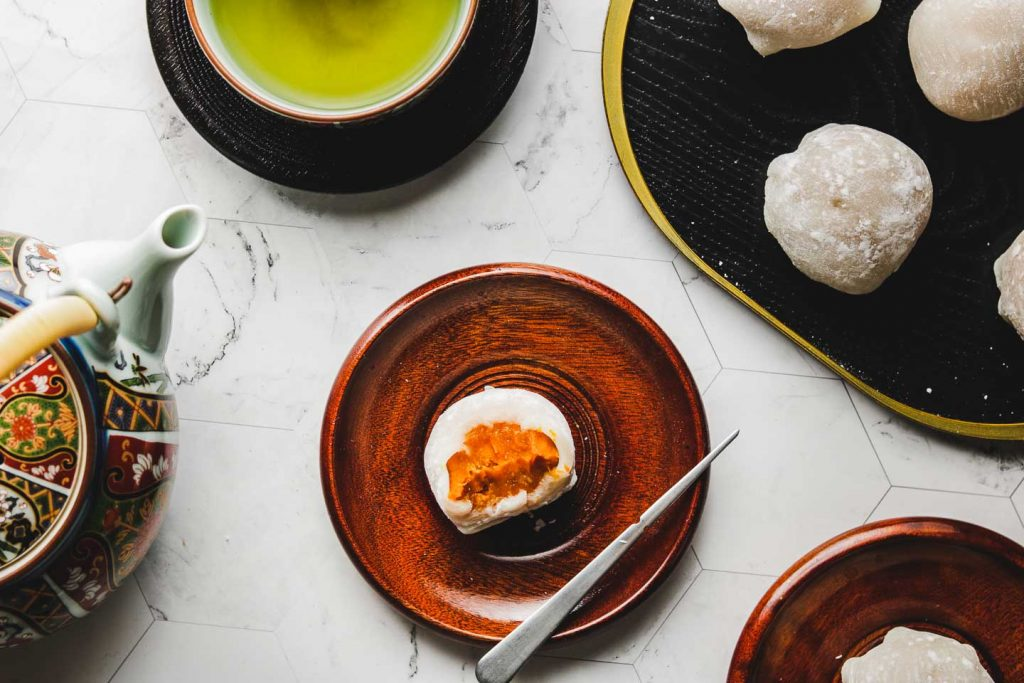japanese pumpkin daifuku mochi on brown plate landscape photo