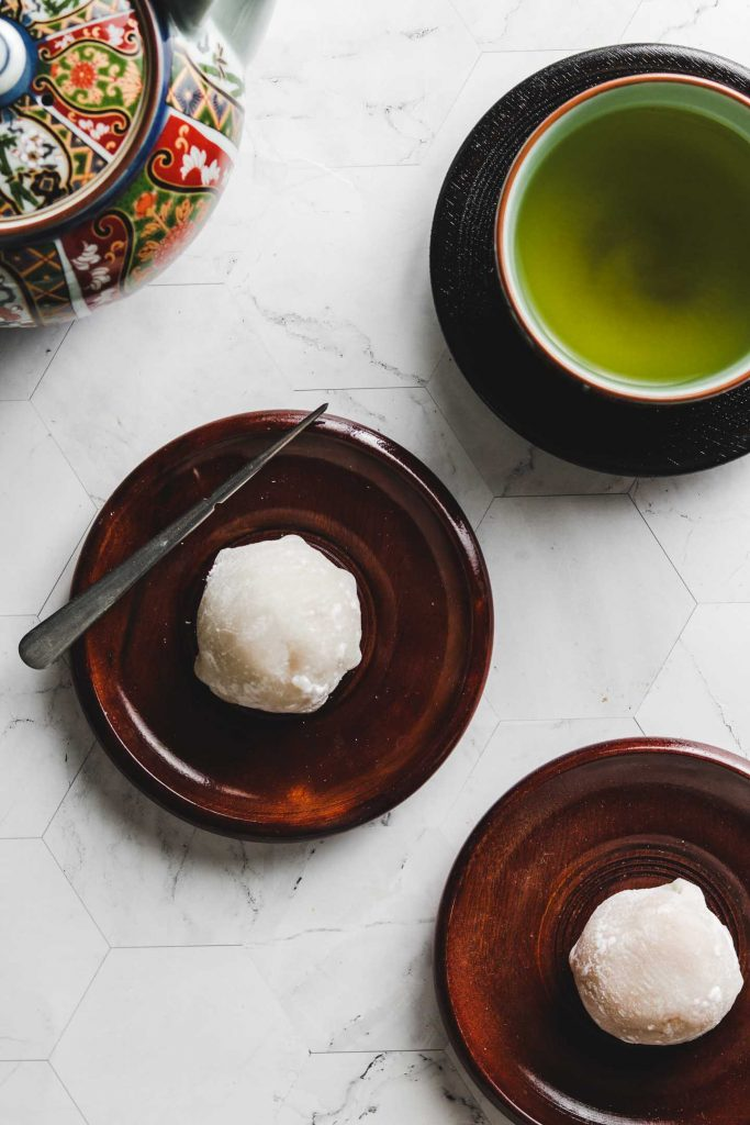 japanese kabocha pumpkin daifuku mochi on brown plate
