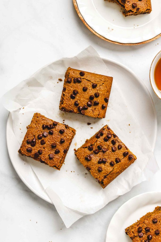 vegan blondies with chocolate on a plate