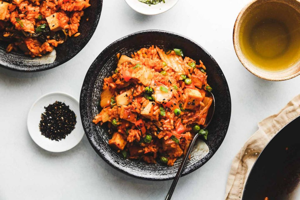 vegan kimchi fried rice in a black bowl landscape photo