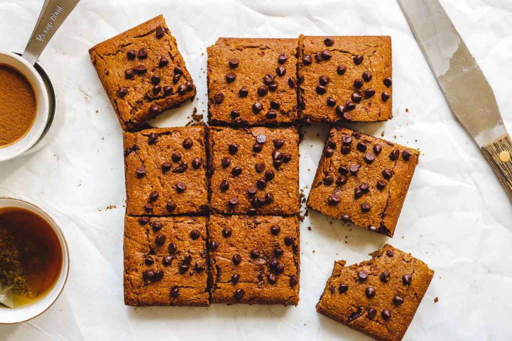 pumpkin spice vegan blondies with chocolate chips on top cut into 9 pieces landscape photo
